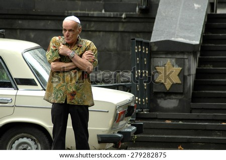 TBILISI - JULY 3: Elder Jewish man stands in the front of the Tbilisi Great Synagogue. Tbilisi has a Jewish population of about 10,000. On July 3, 2006 in Tbilisi, Georgia - stock photo