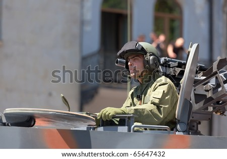TBILISI - MAY 26: The Independence Day of Georgia. Officer in a tank on military parade. May 26, 2010 in Tbilisi, Georgia. - stock photo