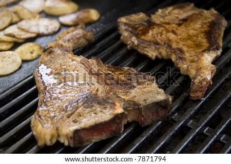 tbone steak on a bbq hotplate - stock photo