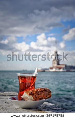 tea and bagel against sea and Maidens Tower in istanbul, Turkey - stock photo