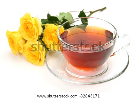 Tea and bouquet of roses
