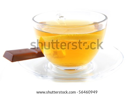 tea and chocolate bar over white background