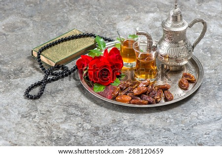 Tea and red rose flower, holy book quran and rosary. Islamic holidays decoration. Ramadan kareem. Eid mubarak. Oriental hospitality concept.  - stock photo