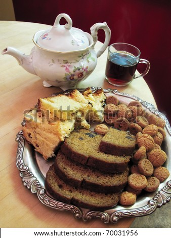Tea and selection of cakes and cookies - stock photo