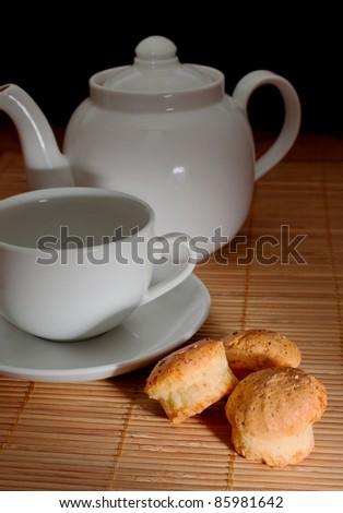 Tea and teapot on the bamboo napkin