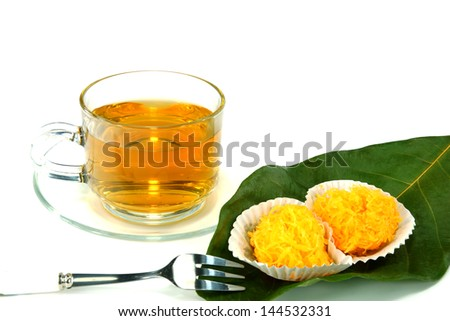 Tea and Thai Sweetmeat on isolate white background. - stock photo