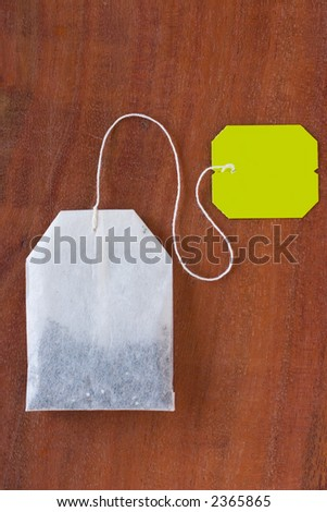 Tea bag bag on wood background