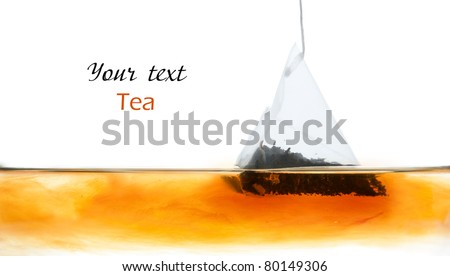 Tea bag in water on the white background - stock photo