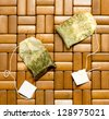 tea bag on a wooden background - stock photo