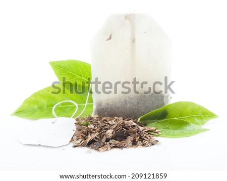 Tea bag with leaves isolated on white background - stock photo