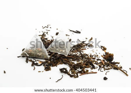 tea bags and loose green tea on a white background  - stock photo