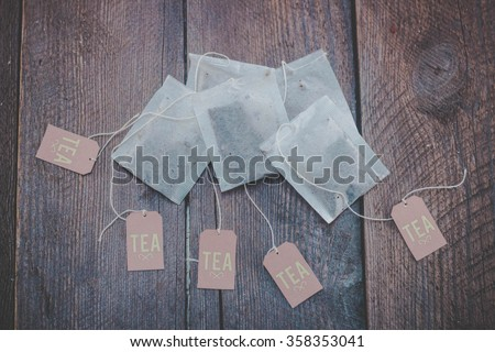 Tea bags on wooden background - stock photo