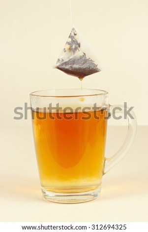 Tea bags over the glass with brewed tea - stock photo