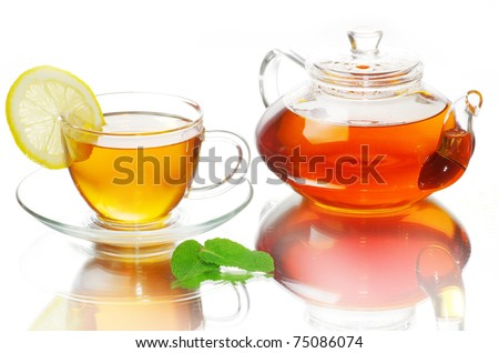 tea being poured into glass tea cup - stock photo