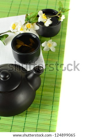 Tea border - teapot, cup, leaves, green background - stock photo