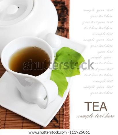 Tea breakfast (still life with tea cup and fresh green leaves isolated on white background with sample text)