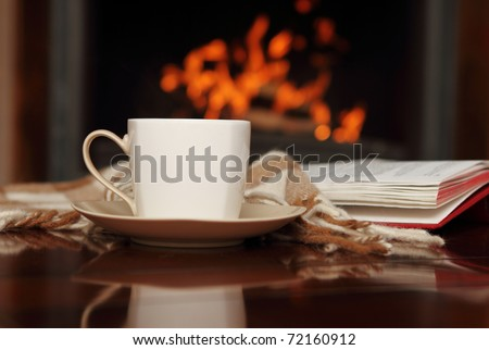 Tea by the fireplace - stock photo