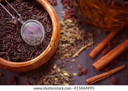 tea composition with cinnamon sticks, lemons - stock photo