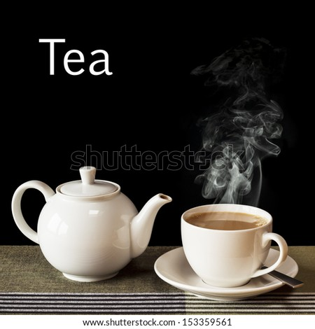 Tea concept - a hot, steaming cup of tea with a teapot, on a black background with the word Tea in white.