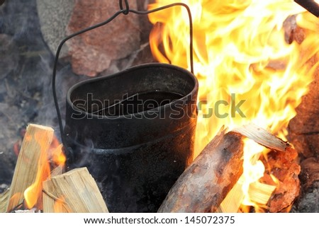 tea, cooked on fire - stock photo
