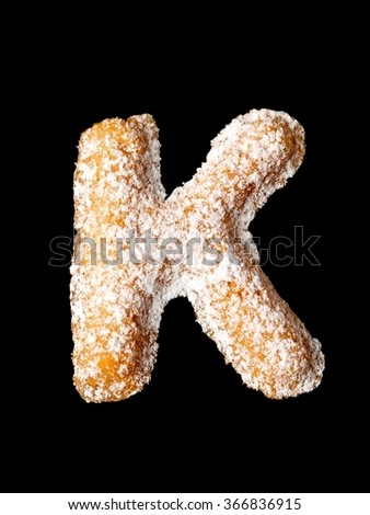 Tea cookie with powder sugar, K letter of the alphabet - stock photo