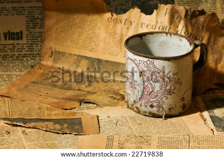 tea cup and old newspaper - stock photo