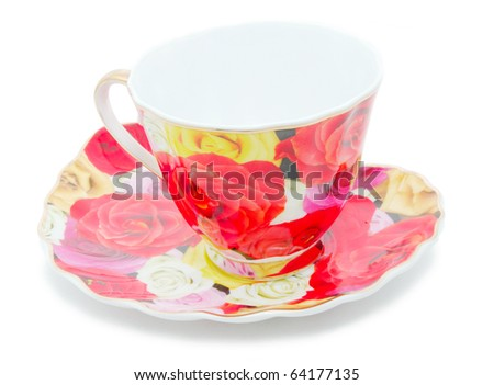 Tea cup and saucer on a white background - stock photo
