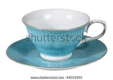 Tea cup and saucer on white background - stock photo