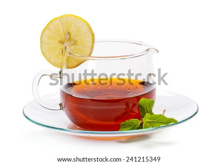 Tea cup and saucer with lemon slice and mint leaf isolated on white background - stock photo