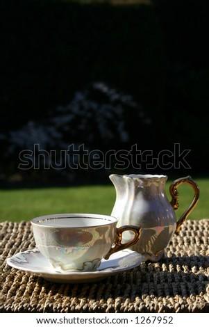 Tea Cup & Milk Jug - stock photo