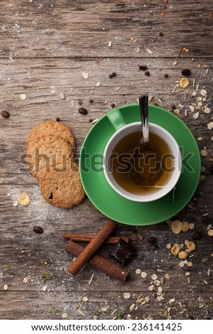 Tea cup on old wooden table. Top view.  - stock photo