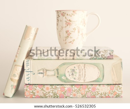 Tea cup over vintage books