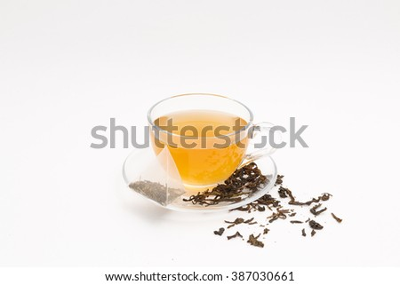 tea cup, tea leaves and tea bag on a white background