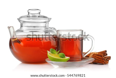 Tea cup, teapot with fresh mint, lime and cinnamon isolated on white background
