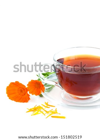 Tea cup with calendula flowers on a white background