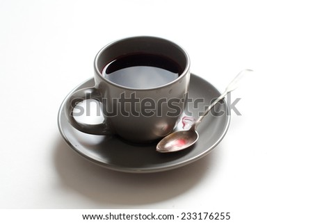 Tea cup with red tea on the table - stock photo