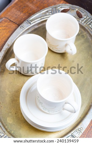 tea cups on silver trace - stock photo