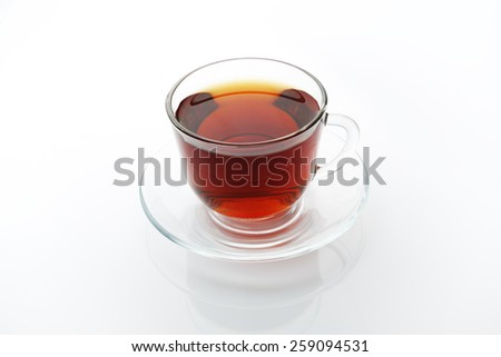 Tea glass cup and saucer isolated at white - stock photo
