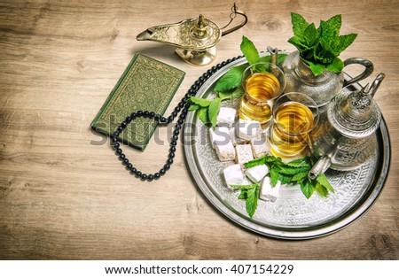Tea glasses and pot. Oriental hospitality concept. Islamic holidays decoration. Ramadan kareem. Eid mubarak. Vintage style toned picture - stock photo