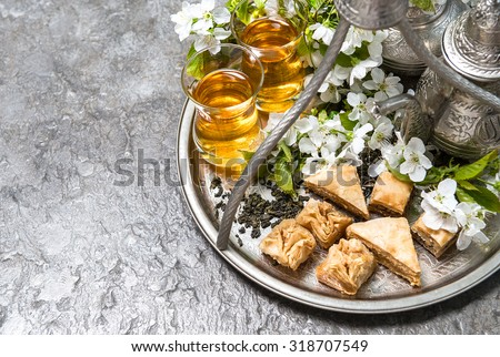 Popular Aid Eid Al-Fitr Food - stock-photo-tea-glasses-and-pot-traditional-sweets-islamic-holidays-decoration-eid-al-fitr-318707549  Perfect Image Reference_12489 .jpg