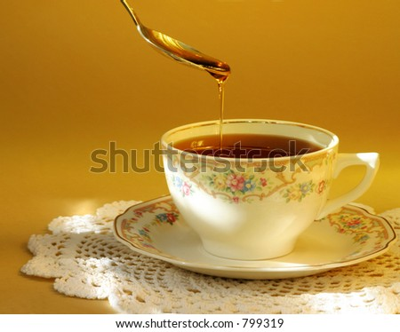 Tea & Honey: A hot cup of tea with a touch of honey... comfort in a cup. - stock photo