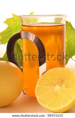 Tea in a glass with lemons near - stock photo