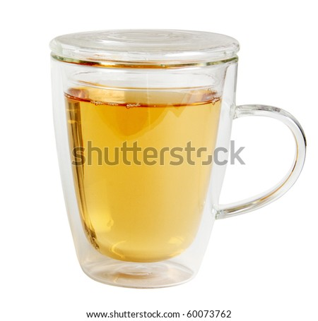Tea in clear glass mug with double wall retains heat with clipping path, isolated