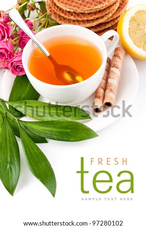 tea in cup with biscuits and lemon isolated on white background - stock photo