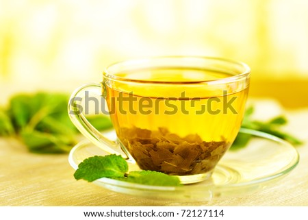 tea in cup with leaf mint - stock photo