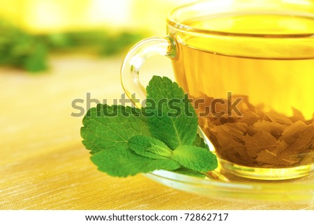 tea in cup with leaf mint