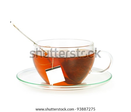 tea in cup with spoon isolated on white