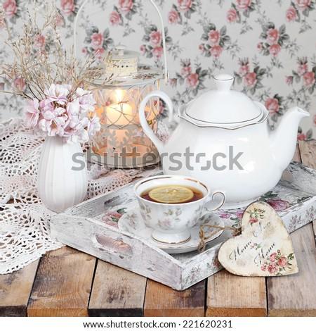 tea in elegant cup in retro style - stock photo