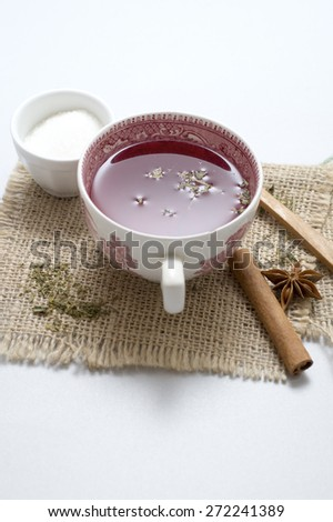 tea in vintage cup on wooden table, close up - stock photo