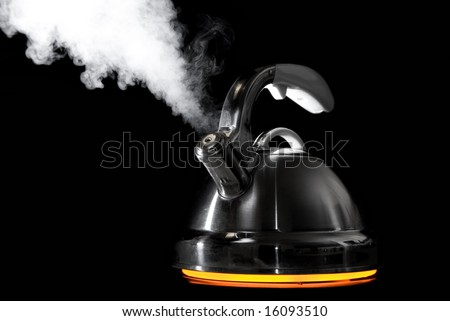 Tea kettle with boiling water. Heater glow under the kettle.